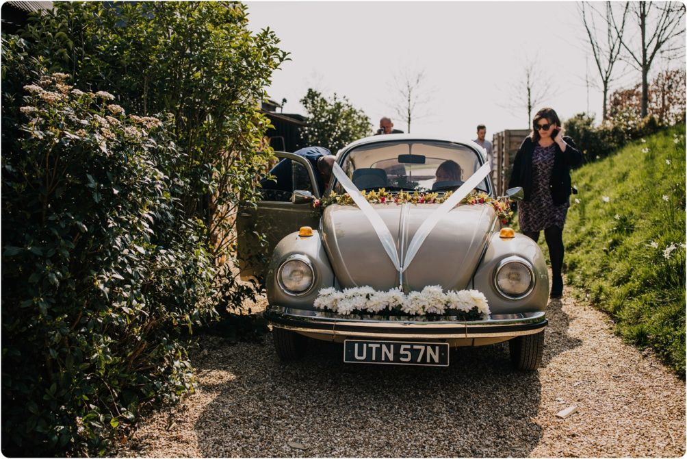 vintage VW Beetle wedding car at a Stone Barn wedding