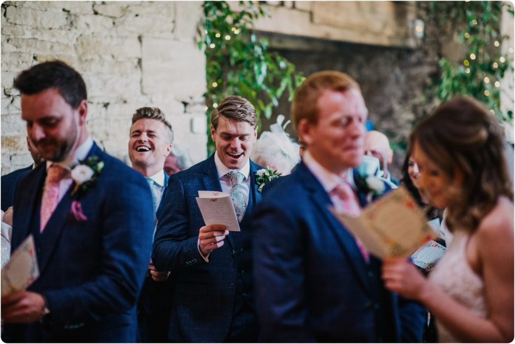 ushers singing at a stone barn wedding