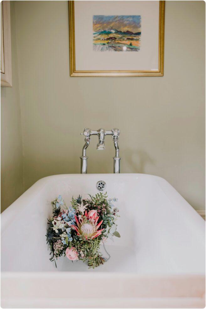 brides bouquet in the bath