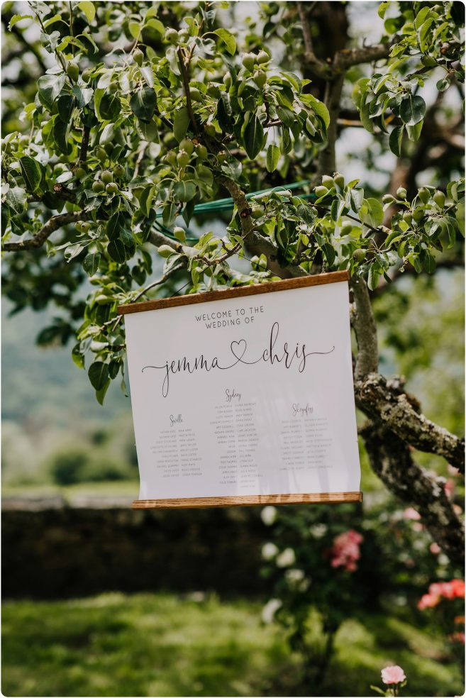 table plan hanging in olive tree