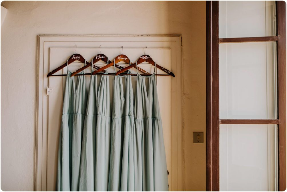 mint green bridesmaids dresses hanging up