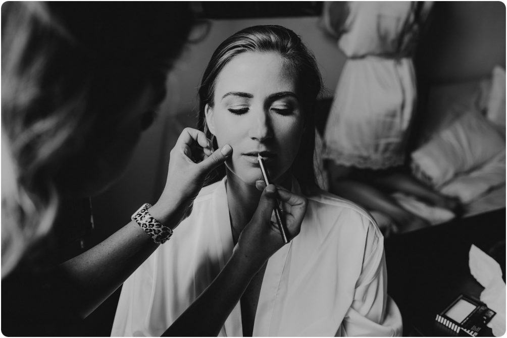 black and white of bride having make up done