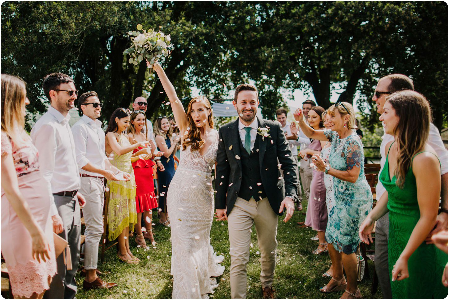 bride and groom walking down confetti aisle montelucci wedding